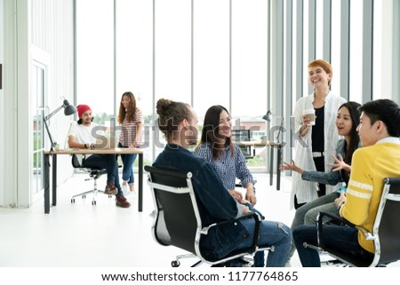 Group of Diversity People Team smiling, laughing and cheerful in small meeting at modern office. Creative Multiethnic teamwork talking together feeling happy, enjoy and engaged with project concept.