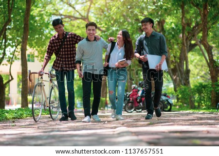 Group of Diversity Student working and walking together in park at university,Happy multiethnic friend study in asian college.Multiethnic and diversity student Concept