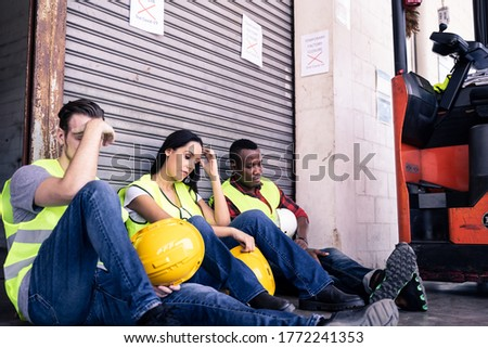 Group of diversity worker feeling sad and stress due to they lost job due to covid virus pandemic. Factory warehouse is closed to prevent infection between people. Big economic impact from coronavirus ストックフォト ©