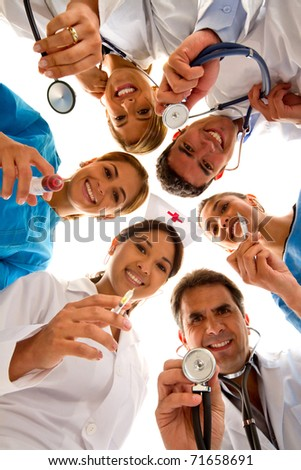 Group of doctors and nurses at the hospital smiling