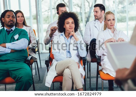 Group of doctors on seminar in lecture hall at hospital. Hospital, profession, people and medicine concept Сток-фото ©
