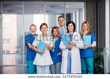 Group of doctors standing in corridor on medical conference.