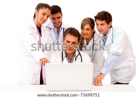 Group of doctors with a laptop isolated over a white background - stock photo