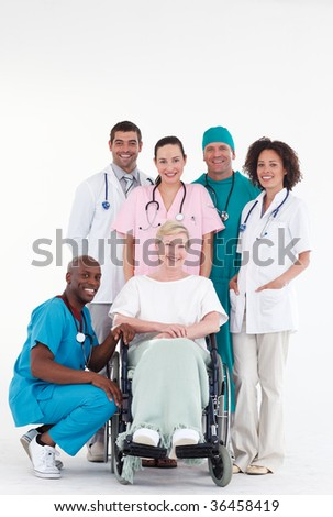 Group of doctors with a patient in a wheel chair