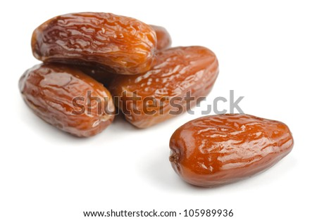 Group of dried date fruits isolated on white
