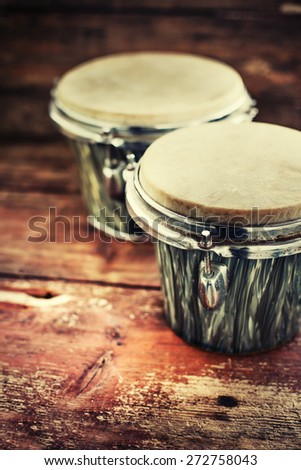 group of drums on dark wooden background