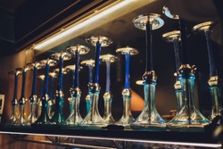 group of eastern hookahs on table close-up.