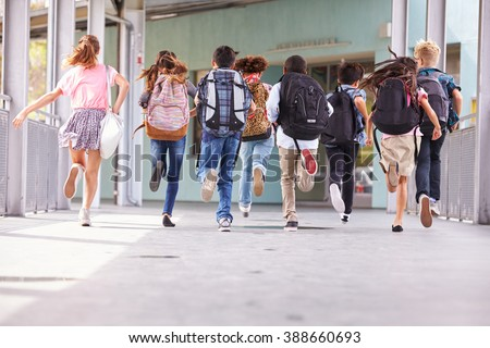 Group of elementary school kids running at school, back view #388660693
