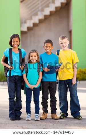 group of elementary school students standing outdoors