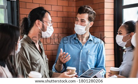 Group of employee staff wearing face mask during talking or working together in company office or public space for prevent flu or coronavirus infection to colleagues, new normal business concept.