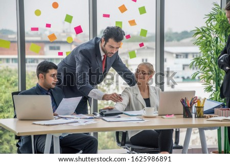 Group of employees and management team work together to brainstorm, solve problems and formulate strategies for working in working space at office.Teamwork concept