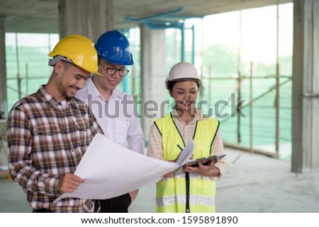 Group of engineer architect and foreman officer meeting about construction working plan on building site