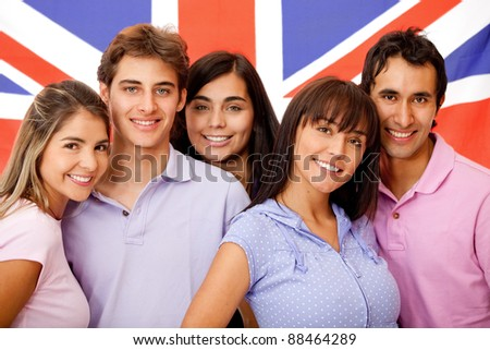 Group of English students with the British flag at the background