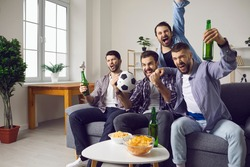 Group of excited men friends football fans feeling happy and celebrating favourite teams goal drinking beer and eating snacks during watching television match at home. Entertainment for male company
