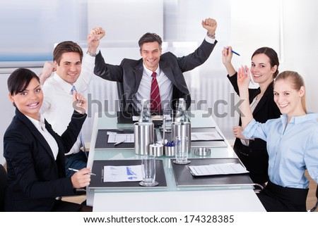 Group Of Excited Multi Ethnic Businesspeople In Office