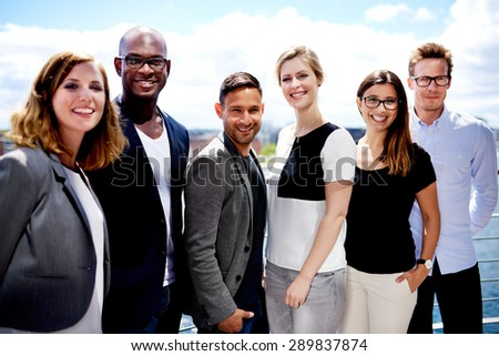 group of executives smiling and ...