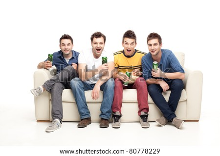 group of exited men sitting together on couch, watching television holding beers, screaming