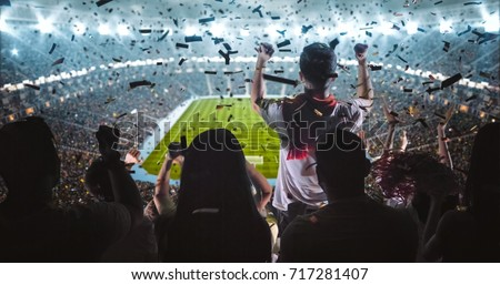 Group of fans are cheering for their team victory