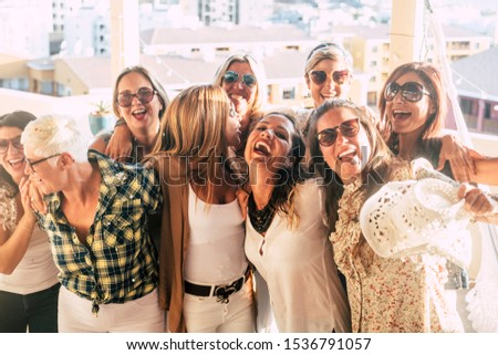 Group of female adult mixed generations people having fun together during party celebration - laughs and smile and cheerful caucasian women together hugging outdoor in friendship #1536791057