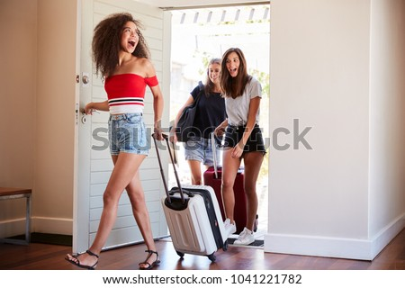 Group Of Female Friends Arriving At Summer Vacation Rental #1041221782