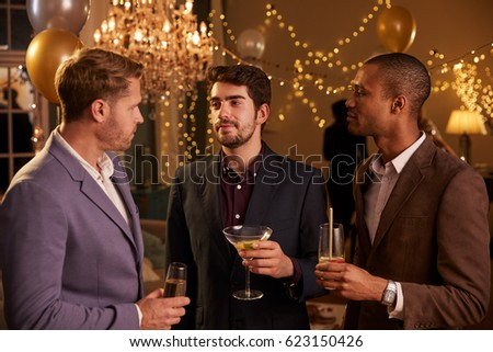 Group Of Female Friends Enjoying Cocktail Party Together