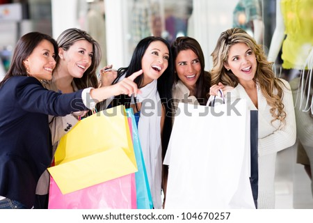 Group of female friends having fun shopping