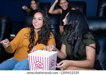 Group of female friends watching a movie in their home theater