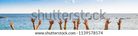 group of female hands in panoramic style with ocean in background, colors and vacation concept. happiness for group of young people in the summer time. joyful and outdoor leisure lifestyle people. #1139578574