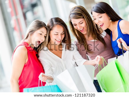 Group of female shoppers looking very excited with their purhcases