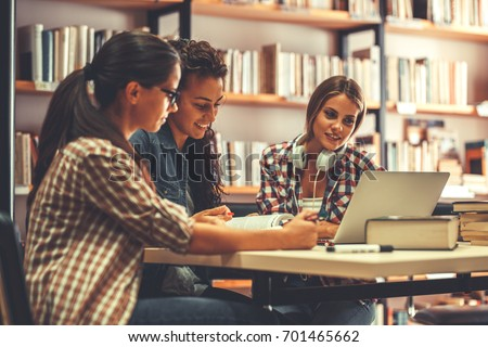 Group of  female students study in the school  library.Learning and preparing for university exam. #701465662