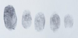 Group of finger prints on white paper texture