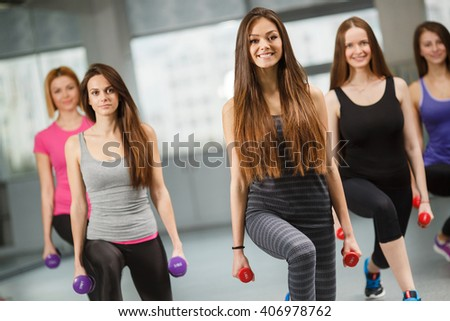Group of fit people at the gym exercising. Group of people in pilates class doing sportrs on fit balls at gym. group of gym people in an aerobics class
