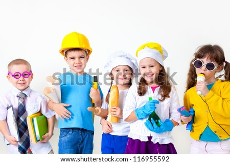 Group of five children dressing up as professions