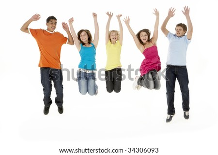 Group Of Five Young Children Jumping In Studio