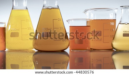 group of flasks and beakers with liquid orange