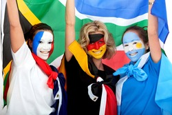 Group of football fans looking happy with their faces painted - Southafrican worl cup 2010