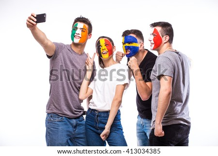 Group of football fans support their national team: Belgium, Italy, Republic of Ireland, Sweden take selfie photo on white background. European football fans concept. #413034385