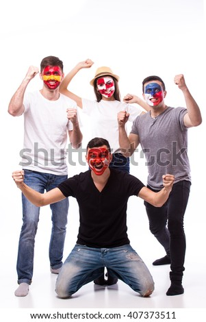 Group of football fans support their national team: Spain, Czech Republic, Turkey, Croatia at camera on white background. European football fans concept. #407373511