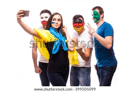Group of football fans their national team: Ukraine, Germany, Poland, Northern Ireland take selfie photo on white background. European football fans concept. #399505099