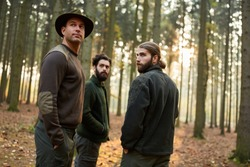 Group of foresters or foresters in the woods in autumn on a patrol