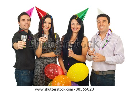 Group of four friends celebrating New Year's Eve together and holding glasses with champagne isolated on white background