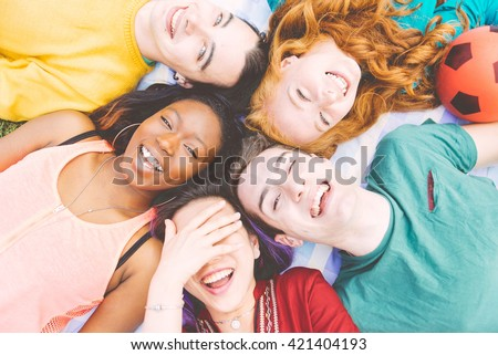 Group of four friends laughing out loud outdoor, sharing good and positive mood. #421404193