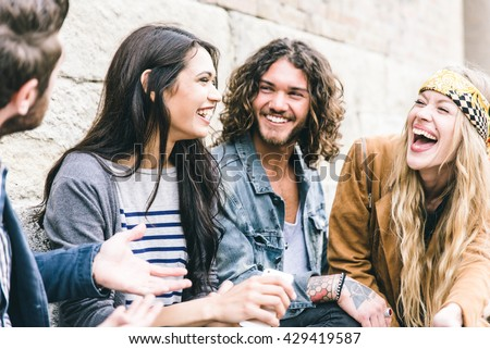 Group of four friends laughing out loud outdoor, sharing good and positive mood #429419587