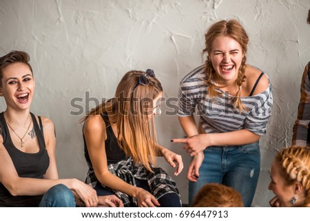 Group of four friends laughing out loud outdoor, sharing good and positive mood #696447913