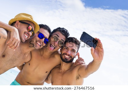 Group of four male friend taking a selfie at the beach #276467516