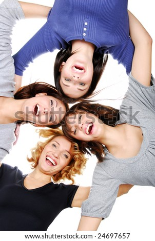 Group of four young adult girls in circle looking at camera