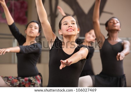 Group of four young Black and Latina dance students