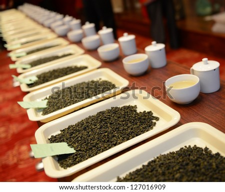 Group of fresh green tea leaves and tea in a row.
