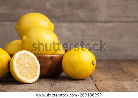 Group of fresh lemon on an old vintage wooden table