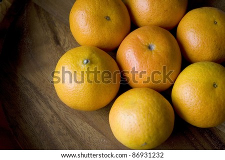 group of fresh oranges on wood background